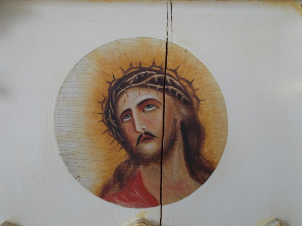 """Jesus is mercy and love. He suffered and died for love of sinners and through His Sacraments wills to heal every broken relationship with the Church and with God. """"Ecce Homo"""" painting at the center of Father Samuel Mazzuchelli's historic altar at Saint Patrick Church in Benton, Wisconsin."""