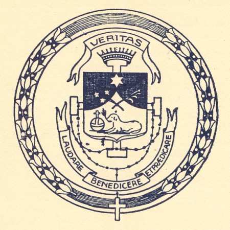 "The historic shield of the Sisters of Third Order of Saint Dominic, of the Congregation of the Most Holy Rosary, of Sinsinawa, as it appeared in The Young Eagle, magazine of Saint Clara Academy, in 1899. What might at first glance seem to be a lamb, is a dog with a torch in its mouth, a symbol of Saint Dominic and his preaching. The top motto: ""TRUTH,"" and at bottom, ""to praise, to bless, and to preach."""